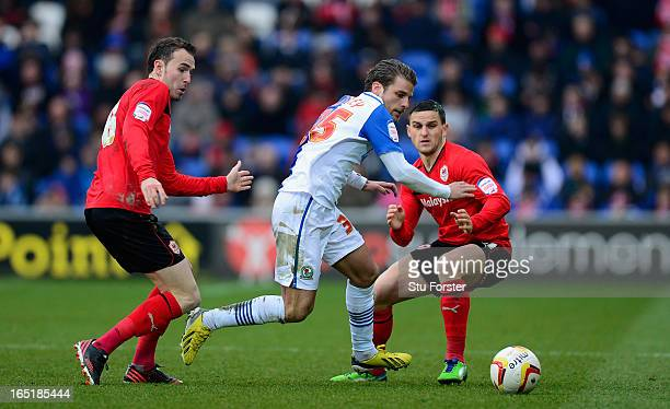 Cardiff City players Jordon Mutch and Craig Conway combine to thwart Blackburn player David Bentley during the npower Championship match between...