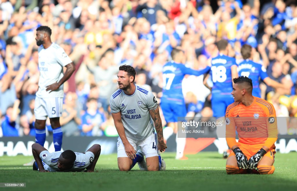 Cardiff City players react following Eden Hazard of Chelsea (not pictured) scoring his side's second goal during the Premier League match between Chelsea FC and Cardiff City at Stamford Bridge on September 15, 2018 in London, United Kingdom.