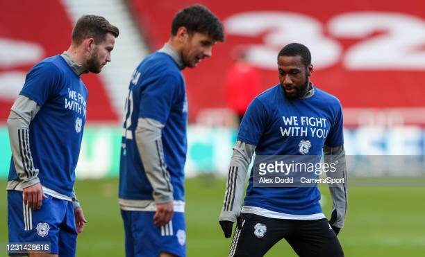 Cardiff City players wear shirts during the warm-up in support of teammate Sol Bamba, who was diagnosed with Non-Hodgkin lymphoma in January during...
