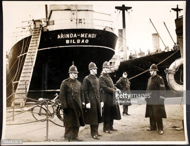 Cardiff City police officers guarding the quayside near the Spanish steamer 'Cristina' following an alleged attempt to hijack the vessel Queen...