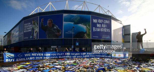 Cardiff City scarves and jerseys flowers messages and other tributes to the football club's new signing Emiliano Sala whose flight disappeared from...