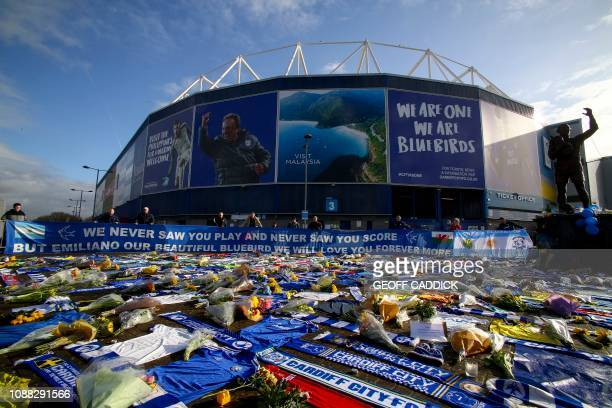 Cardiff City scarves and jerseys, flowers, messages and other tributes to the football club's new signing Emiliano Sala, whose flight disappeared...