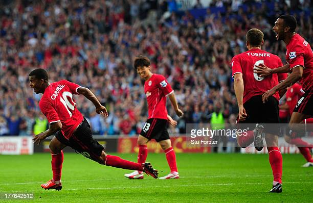 Cardiff City scorers Fraizer Campbell and team mates lead the celebrations after the third Cardiff goal during the Barclays Premier League match...