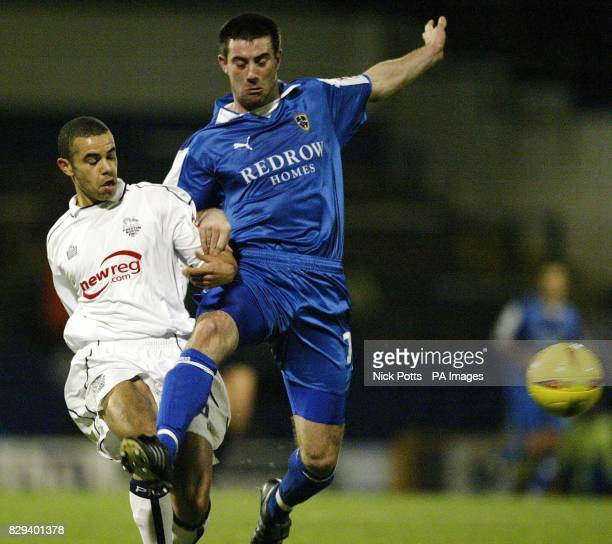 Cardiff City striker Alan Lee tussles for the ball with Preston North End defender Marlon Broomes during the CocaCola League one match at Ninian Park...