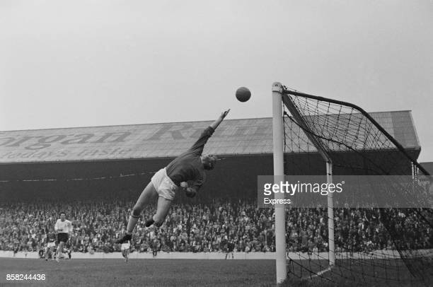 Scottish goalkeeper Bob Wilson of Cardiff City FC tries to make a save 5th September 1964