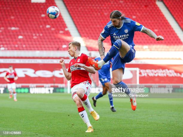 Cardiff City's Aden Flint clears under pressure from Middlesbrough's Duncan Watmore during the Sky Bet Championship match between Middlesbrough and...