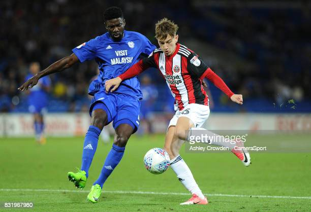 Cardiff City's Bruno Ecuele Manga vies for possession with Sheffield United's David Brooks during the Sky Bet Championship match between Cardiff City...