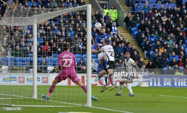 Cardiff City's Callum Paterson sees his header come off the crossbar during the Sky Bet Championship match between Cardiff City and Swansea City at...