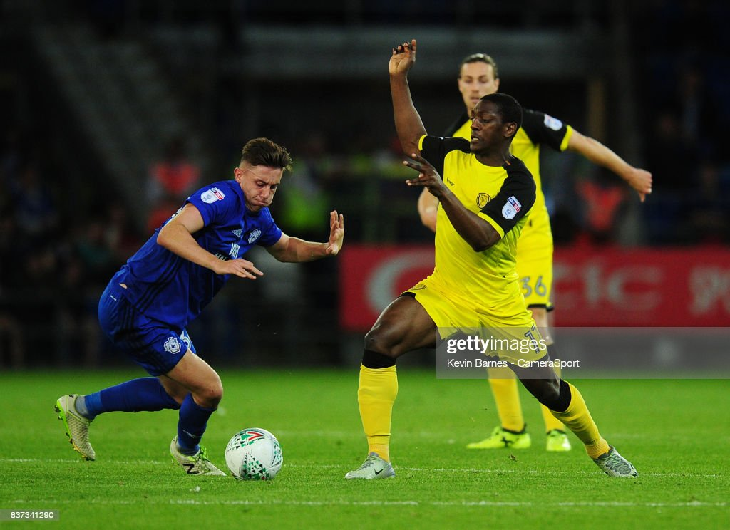Cardiff City's Cameron Coxe under pressure from Burton Albion's Marvin Sordell during the Carabao Cup Second Round match between Cardiff City and Burton Albion at Cardiff City Stadium on August 22, 2017 in Cardiff, Wales.