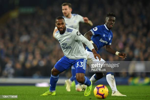 Cardiff City's Canadian midfielder Junior Hoilett vies with Everton's Senegalese midfielder Idrissa Gueye during the English Premier League football...