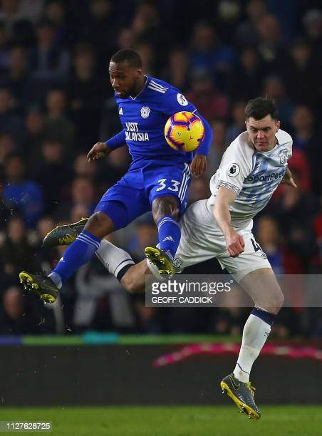 Cardiff City's Canadian midfielder Junior Hoilett vies with Everton's English defender Michael Keane during the English Premier League football match...