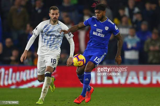 Cardiff City's Dutchborn Caracao midfielder Leandro Bacuna vies with Everton's French midfielder Morgan Schneiderlin during the English Premier...