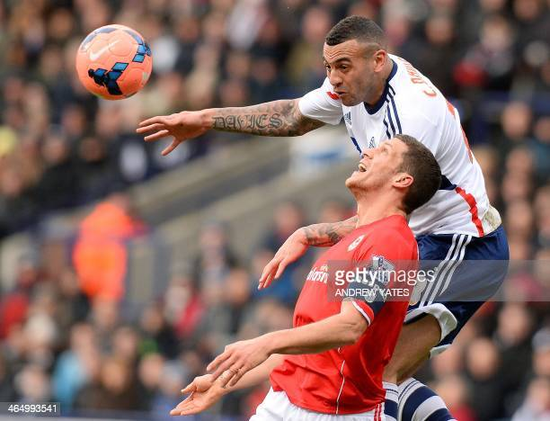 Cardiff City's English defender Mark Hudson vies with Bolton Wanderers' Welsh forward Craig Davies during the English FA Cup fourth round football...