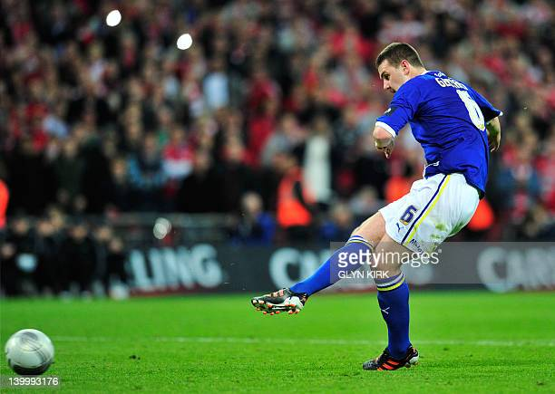 Cardiff City's English footballer Anthony Gerrard takes an unsuccessful penalty in a penalty shoot out against Liverpool in the League Cup Final at...
