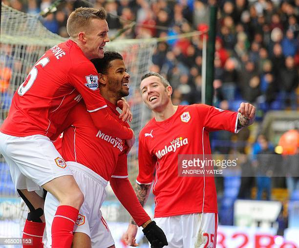 Cardiff City's English forward Fraizer Campbell celebrates after scoring the opening goal with teammates English midfielder Craig Noone and Scottish...