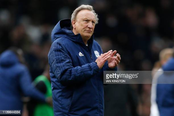 Cardiff City's English manager Neil Warnock applauds supporters as he leaves after the English Premier League football match between Fulham and...