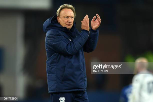 Cardiff City's English manager Neil Warnock applauds supporters on the pitch after the English Premier League football match between Everton and...