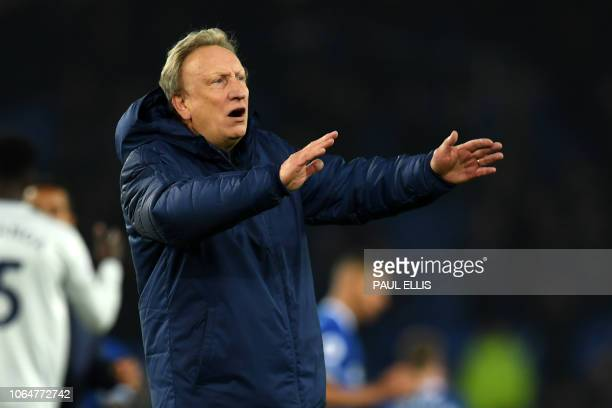 Cardiff City's English manager Neil Warnock gestures on the pitch after the English Premier League football match between Everton and Cardiff City at...
