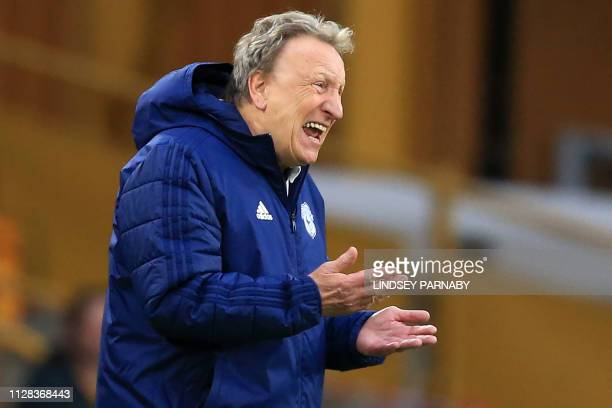 Cardiff City's English manager Neil Warnock gestures on the touchline during the English Premier League football match between Wolverhampton...