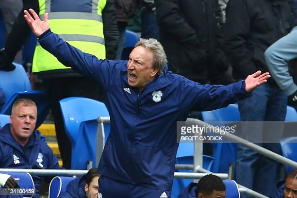 Cardiff City's English manager Neil Warnock gestures on the touchline during the English Premier League football match between between Cardiff City...