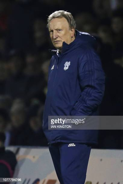 Cardiff City's English manager Neil Warnock looks on as the game nears the end 10 down during the English FA Cup third round football match between...