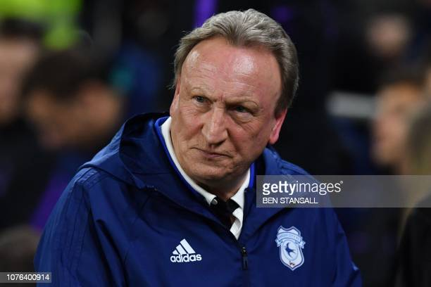 Cardiff City's English manager Neil Warnock reacts ahead of the English Premier League football match between between Cardiff City and Tottenham...
