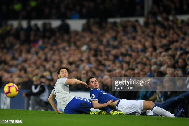 Cardiff City's English midfielder Harry Arter vies with Everton's English defender Michael Keane during the English Premier League football match...