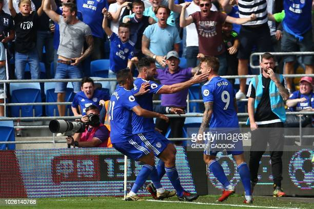Cardiff City's English striker Danny Ward celebrates with teammates after scoring their second goal during the English Premier League football match...