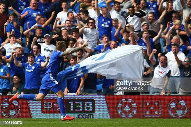 Cardiff City's English striker Danny Ward centre right celebrates after scoring their second goal during the English Premier League football match...