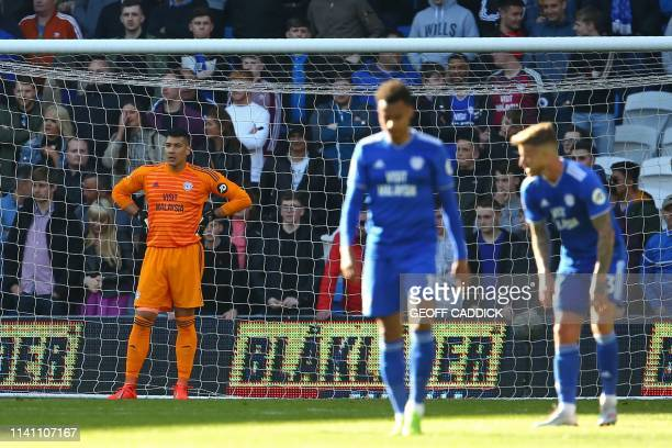 Cardiff City's Englishborn Filipino goalkeeper Neil Etheridge reacts after conceding the opening goal during the English Premier League football...