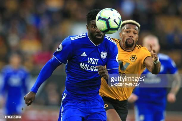 Cardiff City's Gabonese defender Bruno Ecuele Manga vies with Wolverhampton Wanderers' Spanish striker Adama Traore during the English Premier League...