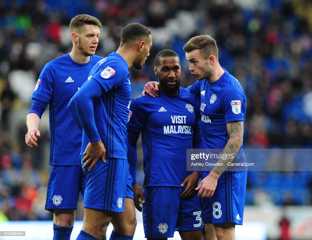 Cardiff City's Greg Halford, Kenneth Zohore, Junior Hoilett and Joe Ralls in discussion during the Sky Bet Championship match between Cardiff City and Middlesbrough at Cardiff City Stadium on February 17, 2018 in Cardiff, Wales.