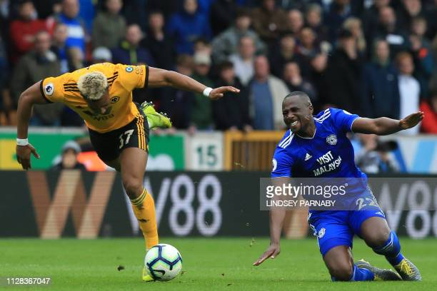 Cardiff City's Ivorian defender Sol Bamba injures himself fouling Wolverhampton Wanderers' Spanish striker Adama Traore during the English Premier...