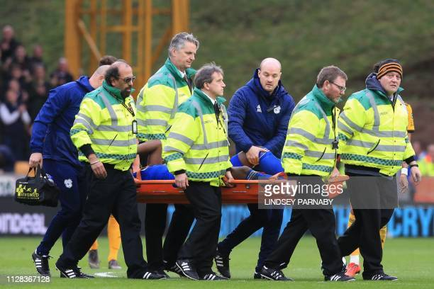 Cardiff City's Ivorian defender Sol Bamba is taken off on a stretcher injured during the English Premier League football match between Wolverhampton...