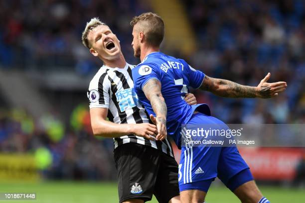 Cardiff City's Joe Bennett and Newcastle United's Matt Ritchie battle for the ball during the Premier League match at the Cardiff City Stadium