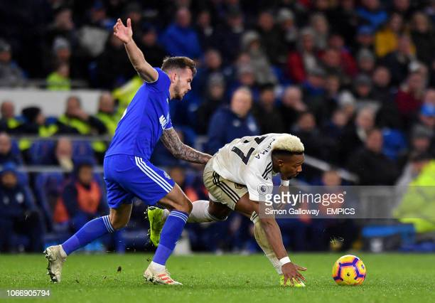 Cardiff City's Joe Ralls and Wolverhampton Wanderers' Adama Traore battle for the ball Cardiff City v Wolverhampton Wanderers Premier League Cardiff...
