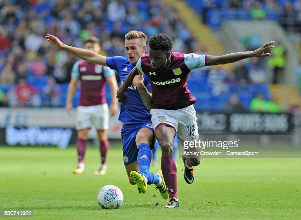 Cardiff City's Joe Ralls battles with Aston Villa's Joshua Onomah during the Sky Bet Championship match between Cardiff City and Aston Villa at...