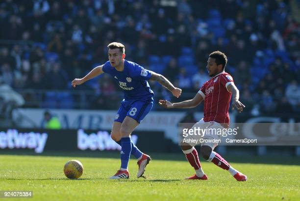 CARDIFF WALES FEBRUARY Cardiff City's Joe Ralls battles with Bristol City's Korey Smith during the Sky Bet Championship match between Cardiff City...
