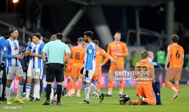 Cardiff City's Joel Bagan receives treatment on the pitch for a shoulder injury before being substituted during the first half during the Sky Bet...