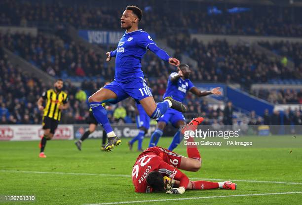 Cardiff City's Josh Murphy and Watford goalkeeper Ben Foster battle for the ball during the Premier League match at the Cardiff City Stadium.