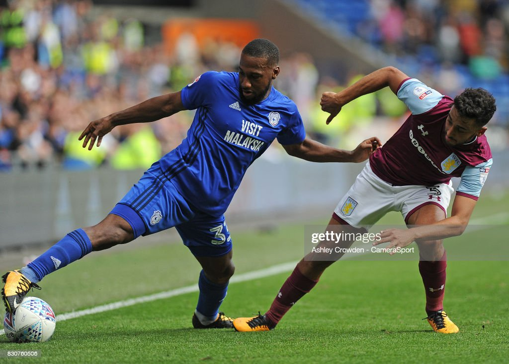 Cardiff City's Junior Hoilett vies for possession with Aston Villa's Neil Taylor during the Sky Bet Championship match between Cardiff City and Aston Villa at Cardiff City Stadium on August 12, 2017 in Cardiff, Wales.