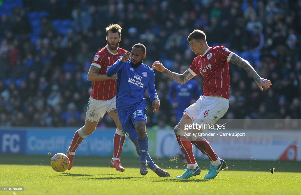 Cardiff City's Junior Hoilett vies for possession with Bristol City's Aden Flint during the Sky Bet Championship match between Cardiff City and Bristol City at Cardiff City Stadium on February 25, 2018 in Cardiff, Wales.