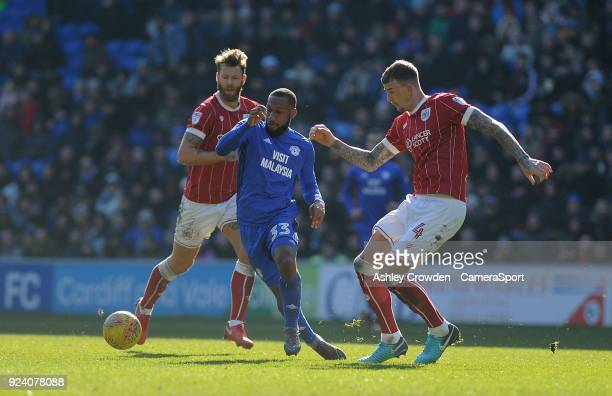 Cardiff City's Junior Hoilett vies for possession with Bristol City's Aden Flint during the Sky Bet Championship match between Cardiff City and...