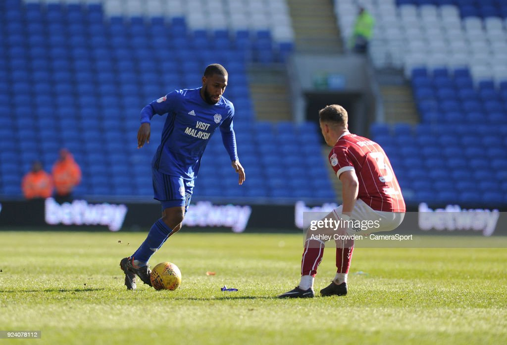 Cardiff City's Junior Hoilett vies for possession with Bristol City's Joe Bryan during the Sky Bet Championship match between Cardiff City and Bristol City at Cardiff City Stadium on February 25, 2018 in Cardiff, Wales.