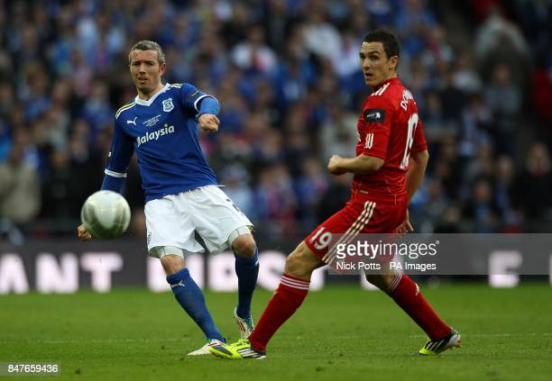 Cardiff City's Kevin McNaughton and Liverpool's Stewart Downing battle for the ball