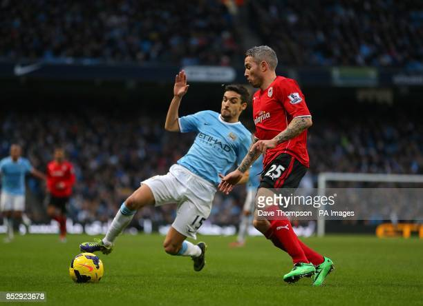 Cardiff City's Kevin McNaughton and Manchester City's Gonzalez Jesus Navas battle for the ball