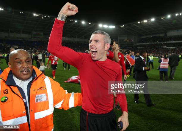 Cardiff City's Kevin McNaughton celebrates gaining promotion to Premier League during the npower Football League Championship match at the Cardiff...