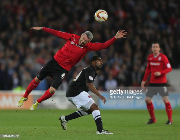 Cardiff City's Kevin McNaughton wins header beating Charlton Athletic's Ricardo Fuller during the npower Football League Championship match at the...
