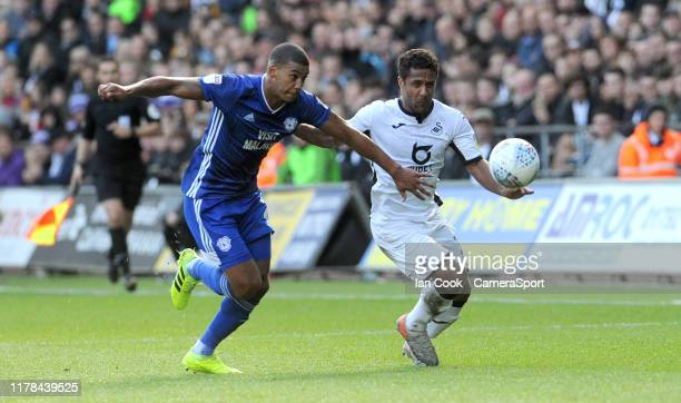 Cardiff City's Lee Peltier battles with Swansea City's Wayne Routledge during the Sky Bet Championship match between Swansea City and Cardiff City at...
