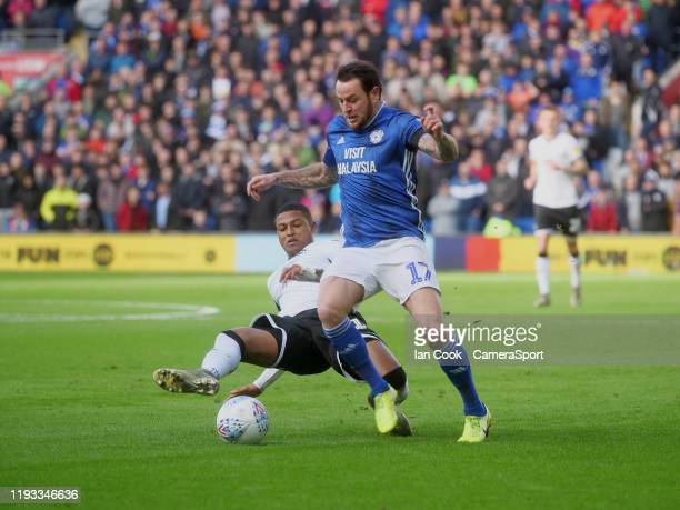 Cardiff City's Lee Tomlin is tackled by Swansea City's Rhian Brewster during the Sky Bet Championship match between Cardiff City and Swansea City at...